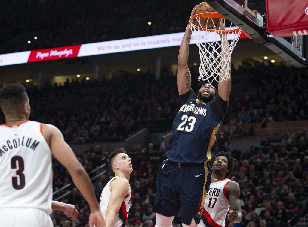 New Orleans Pelicans forward Anthony Davis dunks against the Portland Trail Blazers during the first half in Game 1 of an NBA basketball first-round p