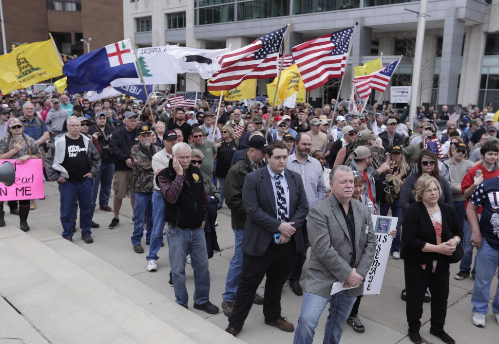 People participate in a gun-rights rally at the state capitol, Saturday, April 14, 2018, in Indianapolis. The rally come less than three weeks after h