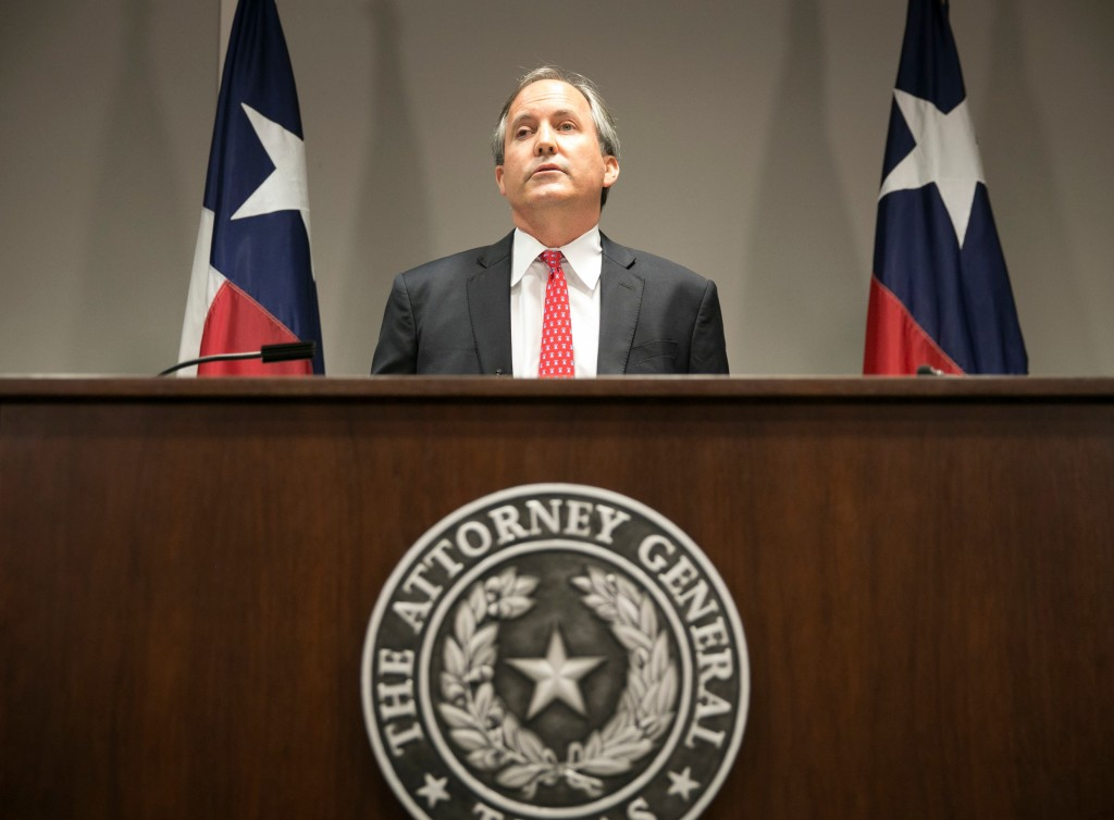 FILE - In this May 25, 2016 file photo, Republican Texas Attorney General Ken Paxton announces the state's lawsuit to challenge President Barack Obama