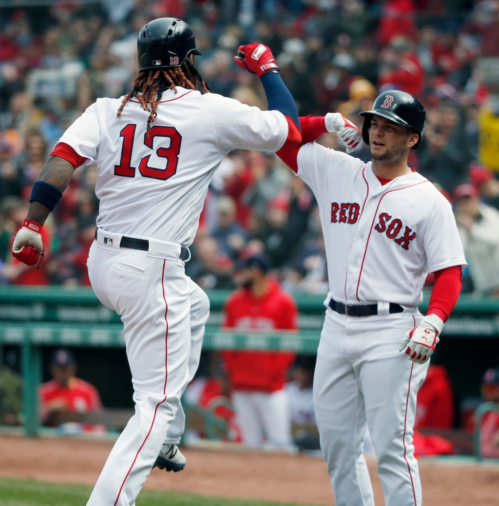 Boston Red Sox's Hanley Ramirez (13) celebrates his two-run home run that also drove in Andrew Benintendi, right, during the first inning of a basebal