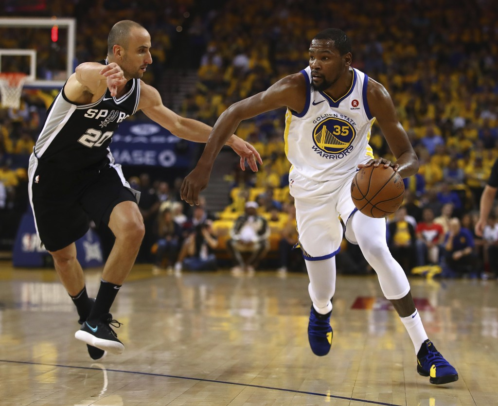 Golden State Warriors' Kevin Durant, right, drives the ball against San Antonio Spurs' Manu Ginobili (20) during the first half in Game 1 of a first-r
