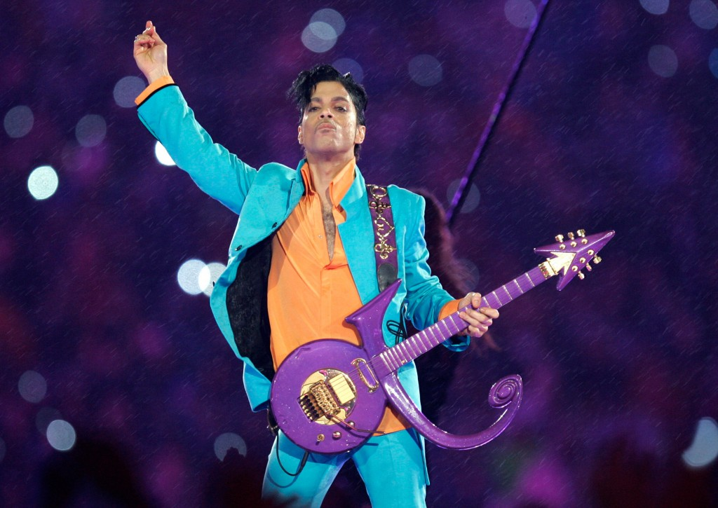 FILE - In this Feb. 4, 2007, file photo, Prince performs during the halftime show at the Super Bowl XLI football game in Miami. The saga to settle Pri