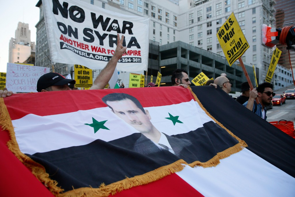 Syrian-Americans express their anger at the missile strikes on their homeland during an anti-war rally opposing the military strikes by Western countr