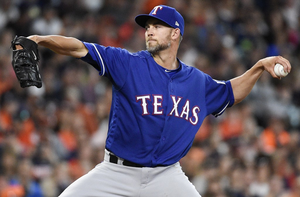 Texas Rangers starting pitcher Mike Minor delivers during the fourth inning of a baseball game against the Houston Astros, Saturday, April 14, 2018, i
