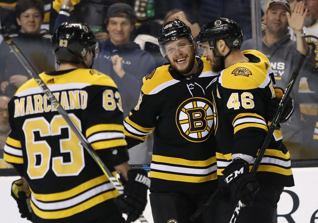 Boston Bruins' David Krejci celebrates his goal with teammates David Pastrnak and Brad Marchand (63) during the second period of Game 2 of an NHL hock