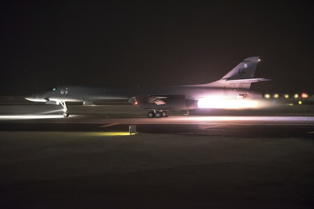This photo provided by the U.S. Air National Guard shows 34th Expeditionary Bomb Squadron B-1B Lancer aircraft departing from Al Udeid Air Base, Qatar