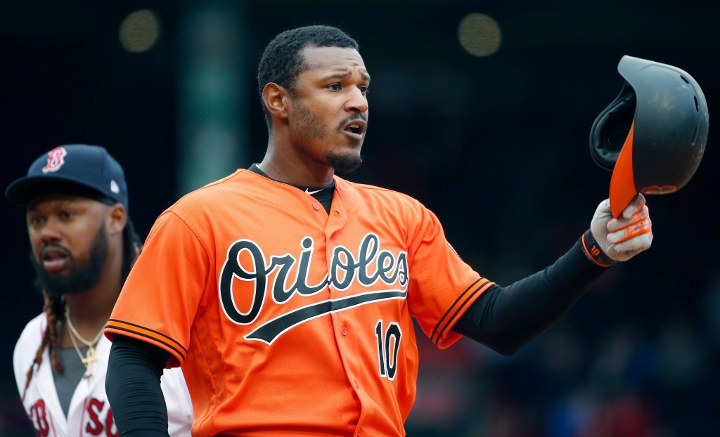 Baltimore Orioles' Adam Jones (10) reacts after grounding into a double play during the eighth inning of a baseball game against the Boston Red Sox in