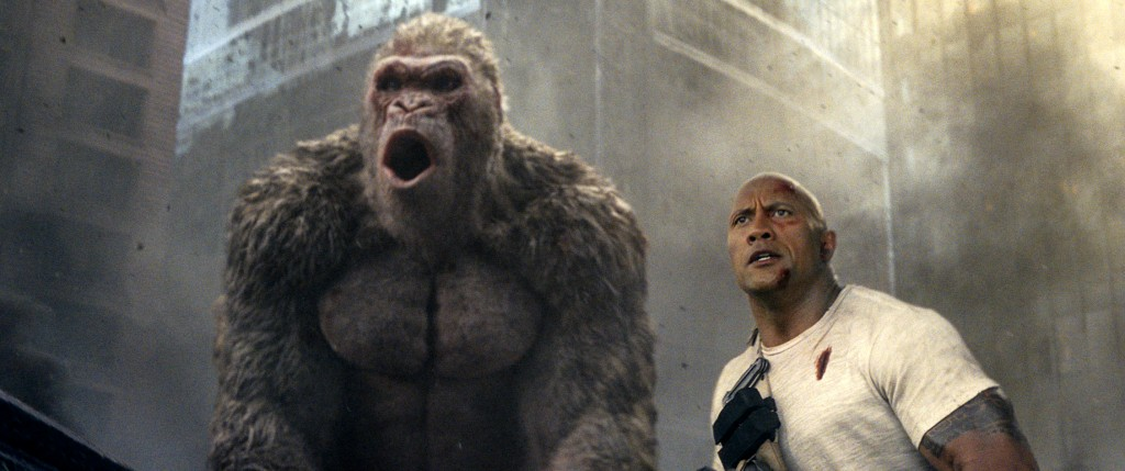 "This image released by Warner Bros. shows Dwayne Johnson in a scene from ""Rampage.""  Johnson's arcade game-inspired ""Rampage"" crept past last week's t"