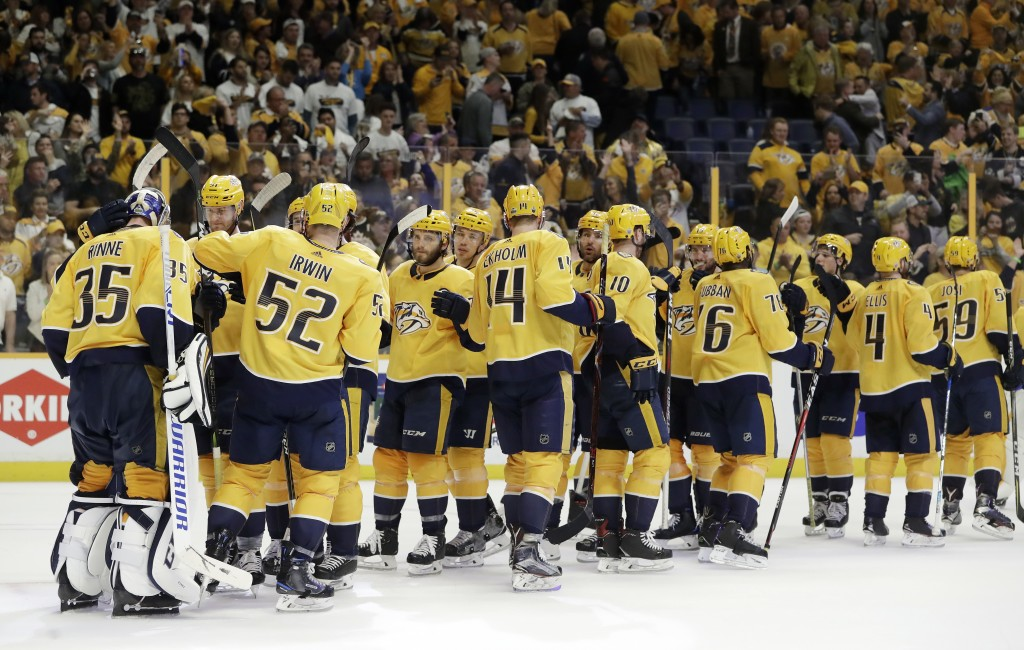Nashville Predators players celebrate after defeating the Colorado Avalanche in Game 2 of an NHL hockey first-round playoff series Saturday, April 14,