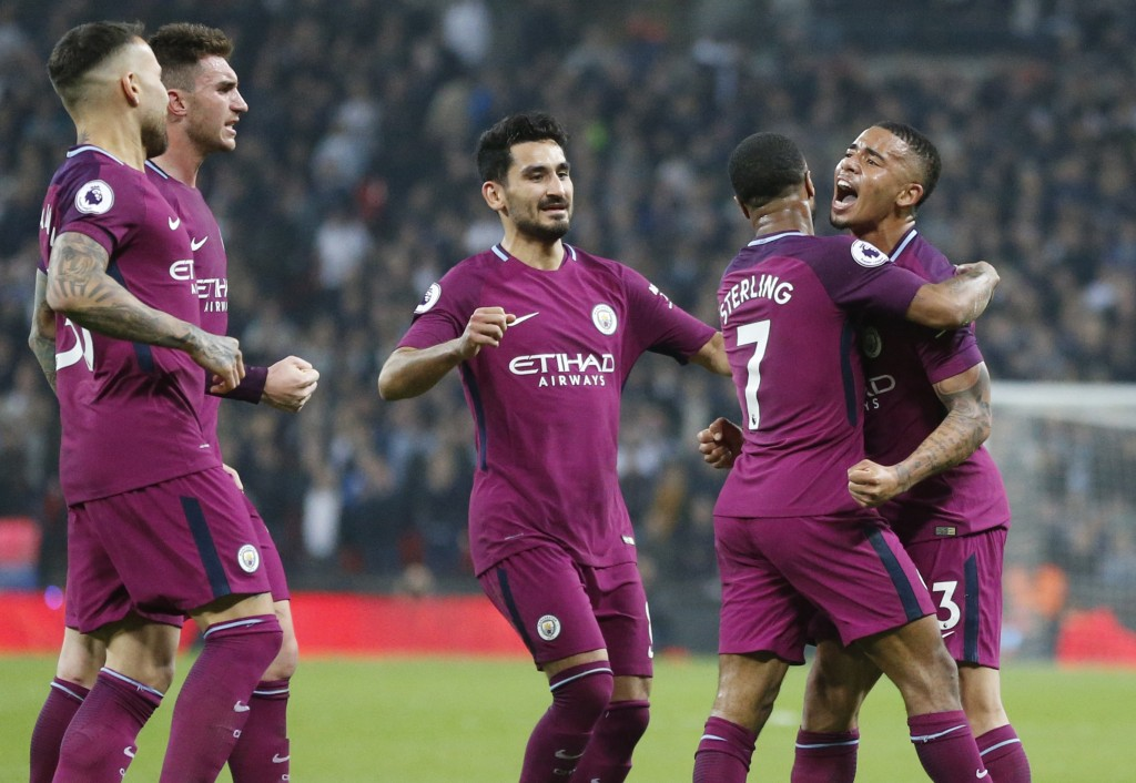 Manchester City's Raheem Sterling, second from right, celebrates with team mates after scoring his sides third goal during the English Premier League