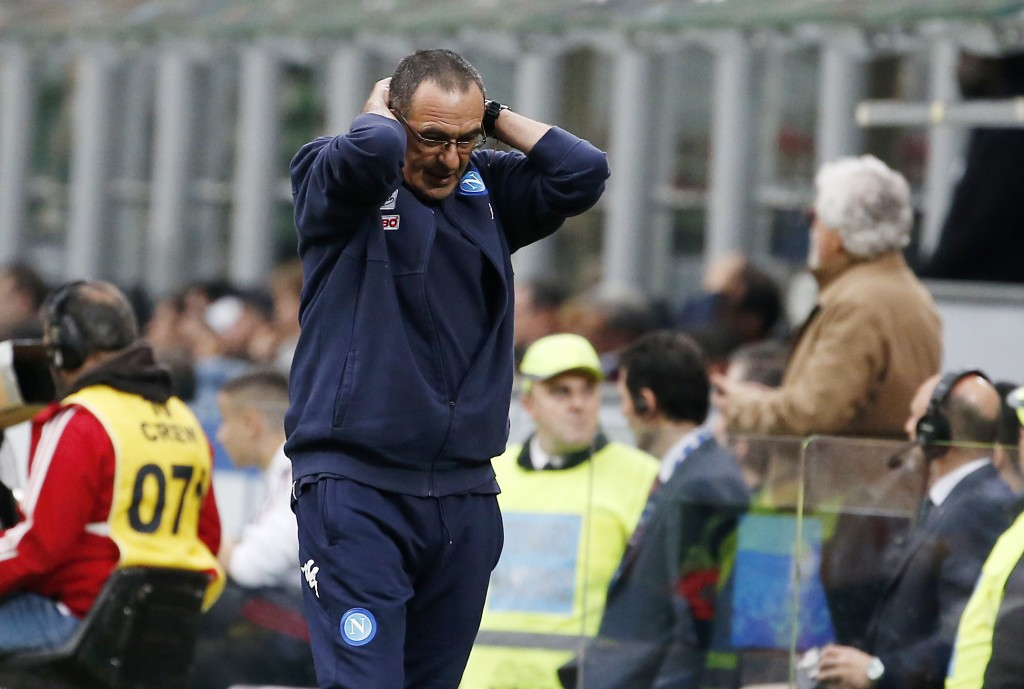 Napoli coach Maurizio Sarri reacts after his players missed a scoring chance during the Serie A soccer match between AC Milan and Napoli at the San Si