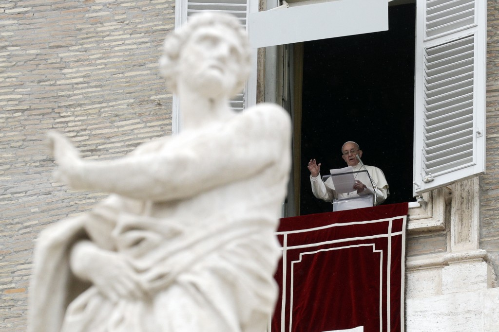 Pope Francis delivers his message during the Regina Coeli noon prayer he delivered from his studio window overlooking St. Peter's Square, at the Vatic