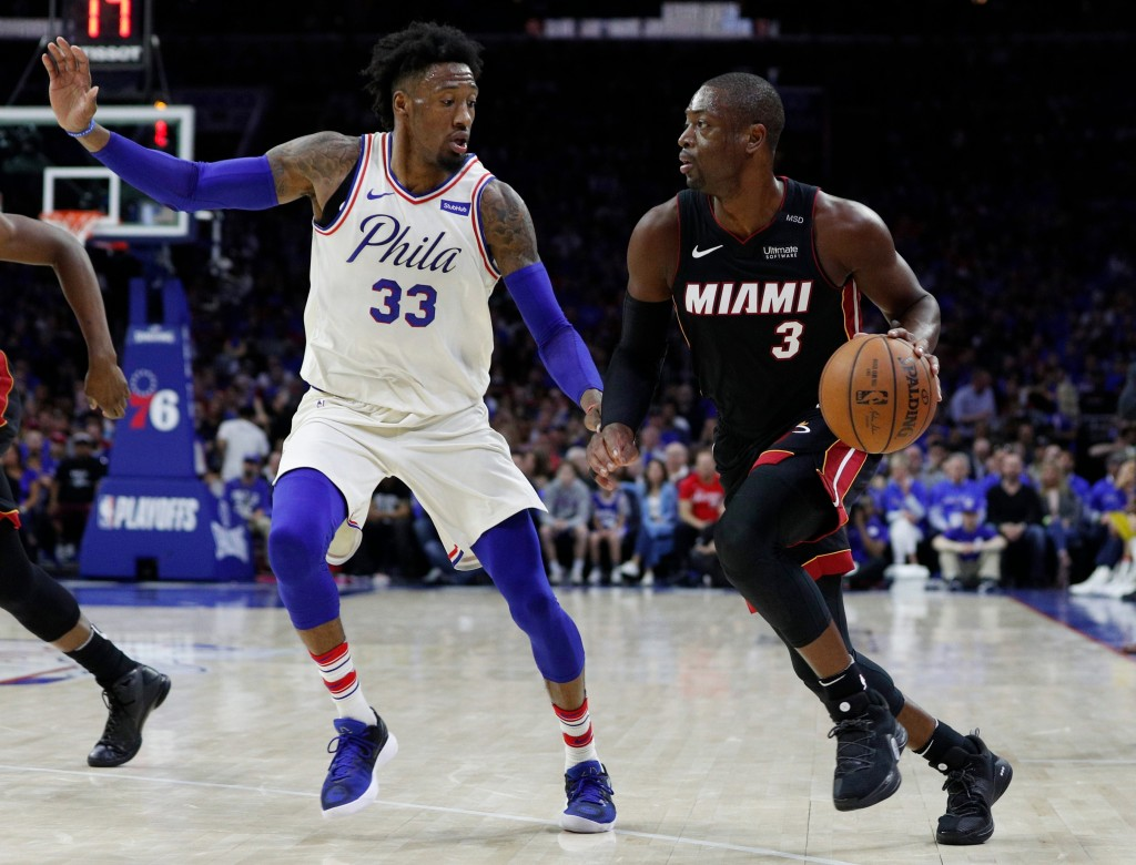 Miami Heat's Dwyane Wade, right, makes a move against Philadelphia 76ers' Robert Covington, left, during the first half in Game 1 of a first-round NBA