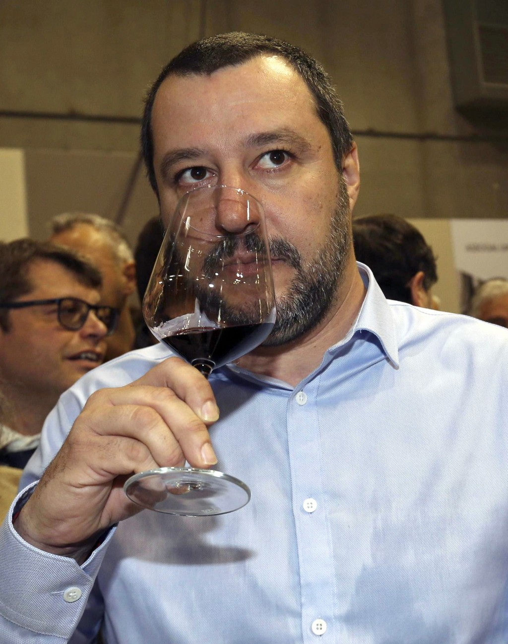 "Leader of the League party Matteo Salvini sips a glass of wine as he visits the "" Vinitaly "" international wine exhibition, in Verona, Italy, Sunday,"