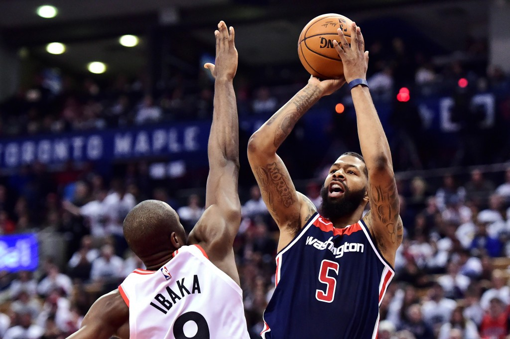Washington Wizards forward Markieff Morris (5) shoots over Toronto Raptors forward Serge Ibaka (9) during the second half of Game 1 of an NBA basketba