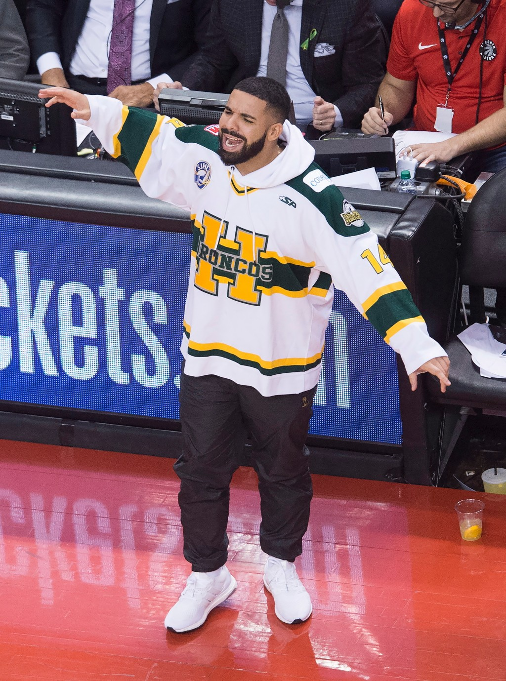 Rapper Drake wears a Humboldt Broncos jersey during the second half of Game 1 of an NBA basketball first-round playoff series between the Washington W
