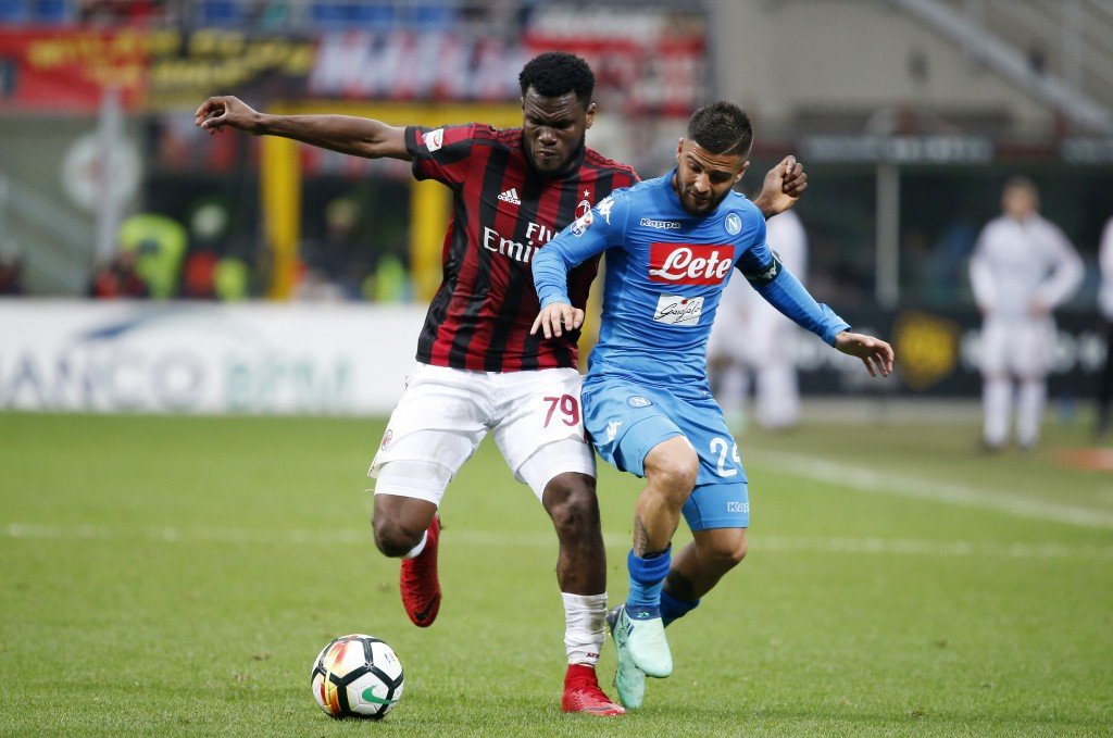AC Milan's Franck Kessie, left, challenges for the ball with Napoli's Lorenzo Insigne during the Serie A soccer match between AC Milan and Napoli at t