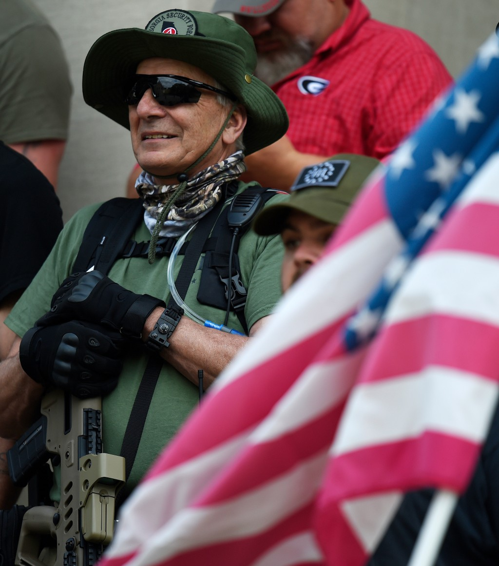 People participate in a gun-rights rally at the state capitol, Saturday, April 14, 2018, in Atlanta.  About 40 gun rights supporters have gathered for