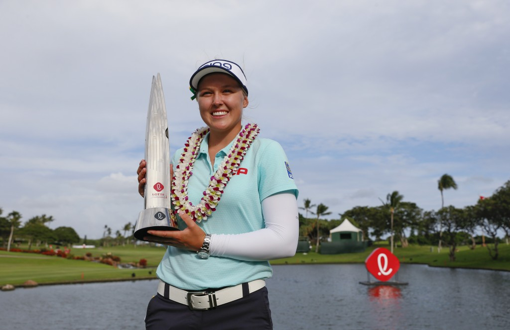 Brooke Henderson, of Canada, holds the trophy after winning the LPGA Lotte Championship golf tournament Saturday, April 14, 2018, in Kapolei, Hawaii.