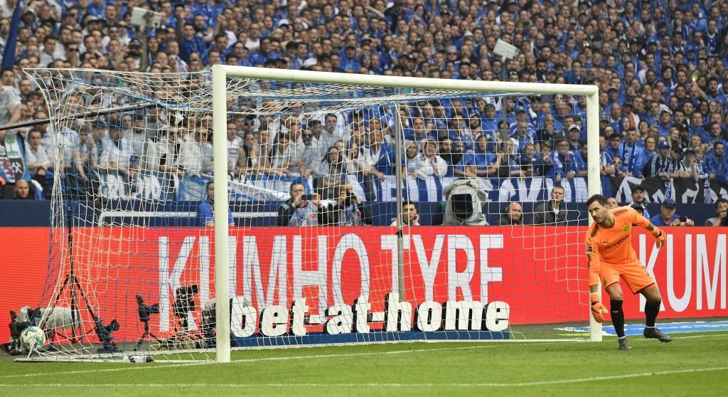 Dortmund goalkeeper Roman Buerki receives the second goal by Schalke's Naldo during the German Bundesliga soccer match between FC Schalke 04 and Borus