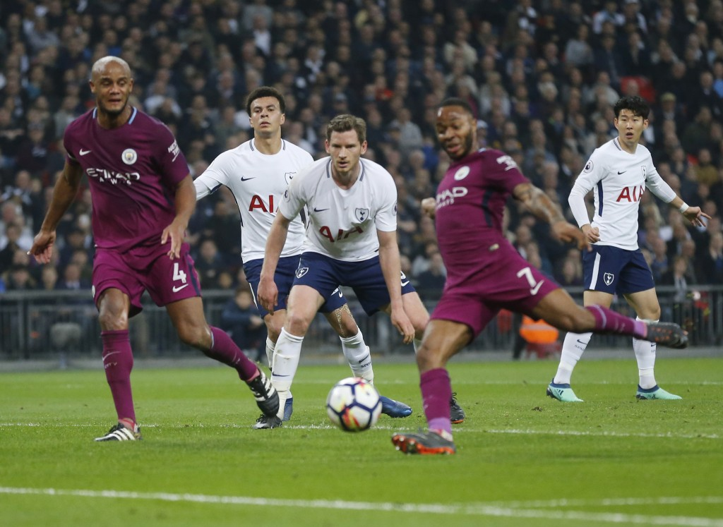 Tottenham Hotspur players look on as Manchester City's Raheem Sterling scores during the English Premier League soccer match between Tottenham Hotspur