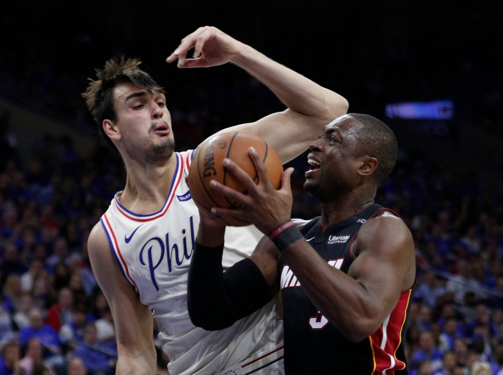 Miami Heat's Dwyane Wade, right, makes his move against Philadelphia 76ers' Dario Saric, left, of Croatia, during the first half in Game 1 of a first-