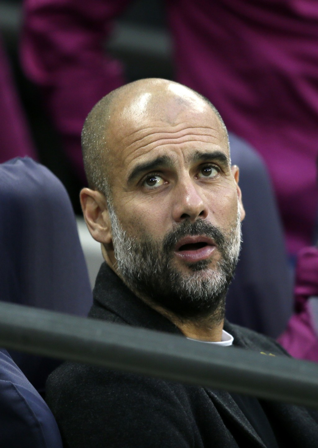 Manchester City coach Pep Guardiola sits on the bench during the English Premier League soccer match between Tottenham Hotspur and Manchester City at