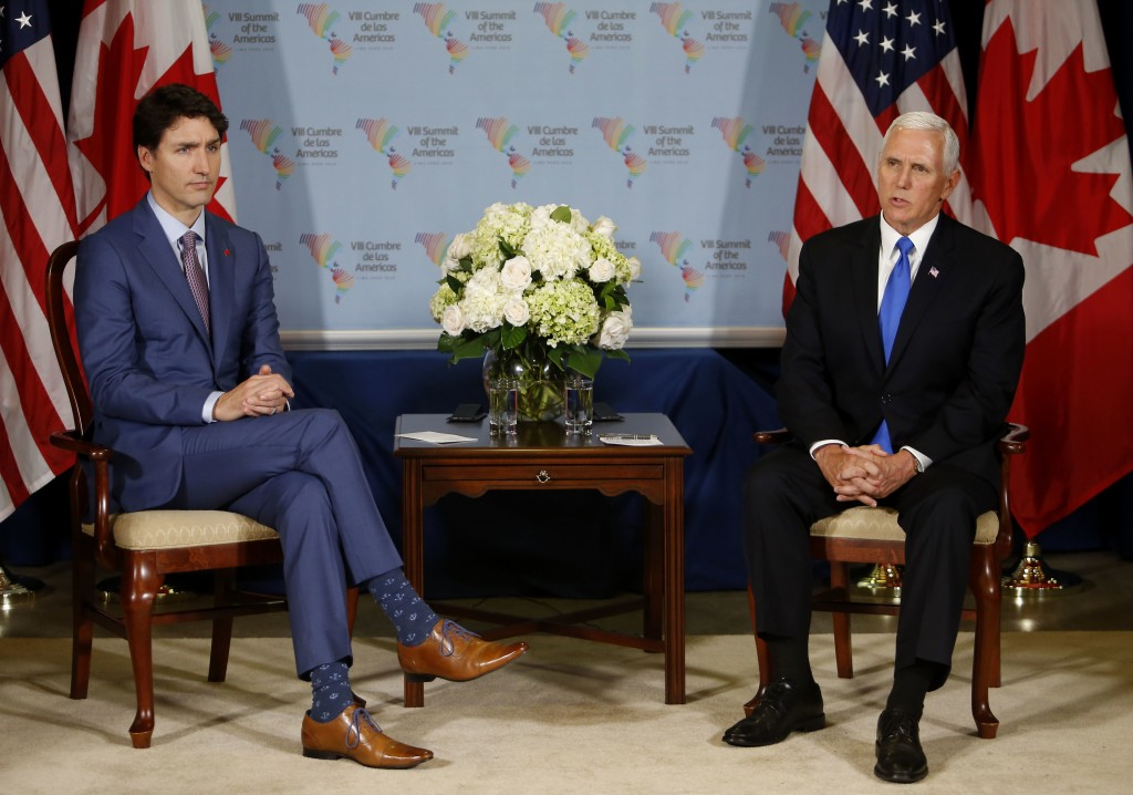 U.S. Vice President Mike Pence, right, meets Canada's Prime Minister Justin Trudeau during a bilateral meeting at the Summit of the Americas in Lima,