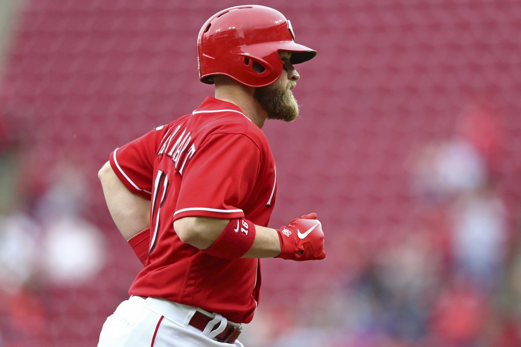 Cincinnati Reds' Tucker Barnhart runs the bases after hitting a home run in the fifth inning of a baseball game against the St. Louis Cardinals, Satur