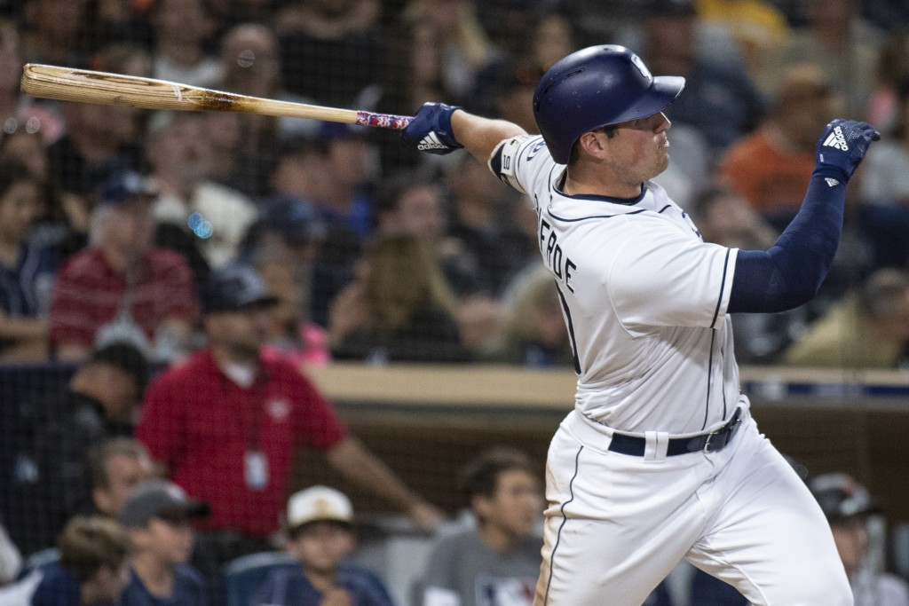 San Diego Padres' Hunter Renfroe watches his two-run home run during the seventh inning of a baseball game against the San Francisco Giants in San Die