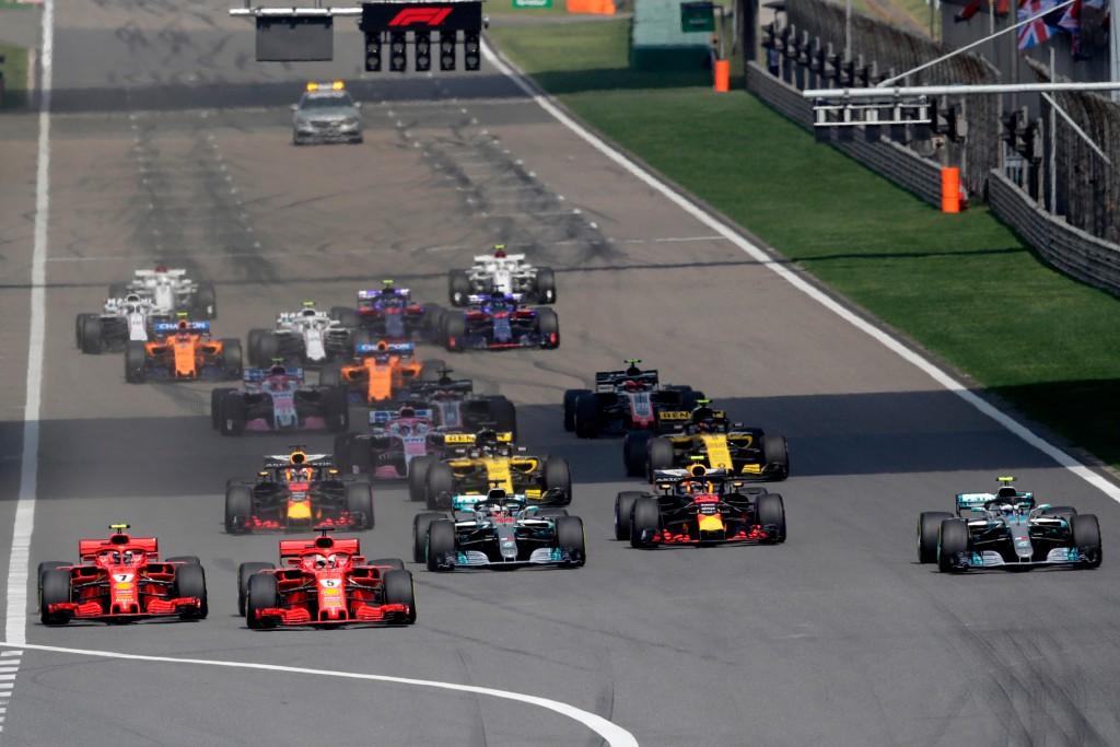 Ferrari driver Sebastian Vettel (5) of Germany leads the field at the start of the Chinese Formula One Grand Prix at the Shanghai International Circui
