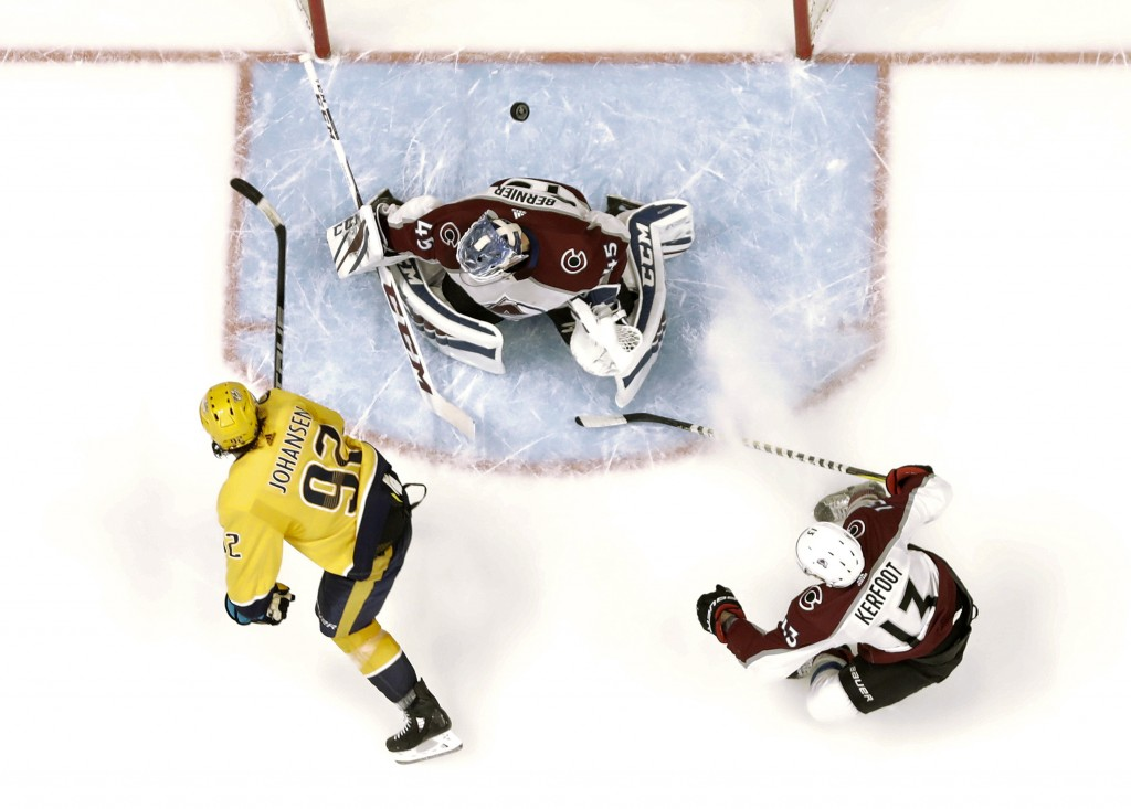 Nashville Predators center Ryan Johansen (92) scores a goal against Colorado Avalanche goaltender Jonathan Bernier (45) during the second period in Ga