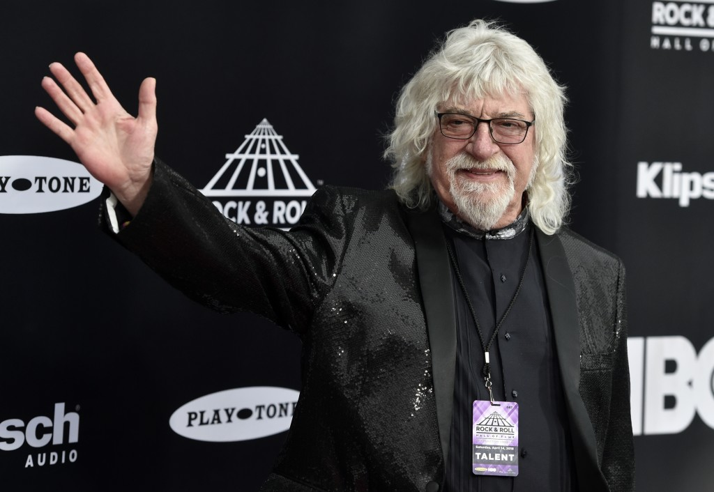 Graeme Edge, drummer for the Moody Blues, waves on the red carpet before the Rock and Roll Hall of Fame Induction ceremony, Saturday, April 14, 2018,