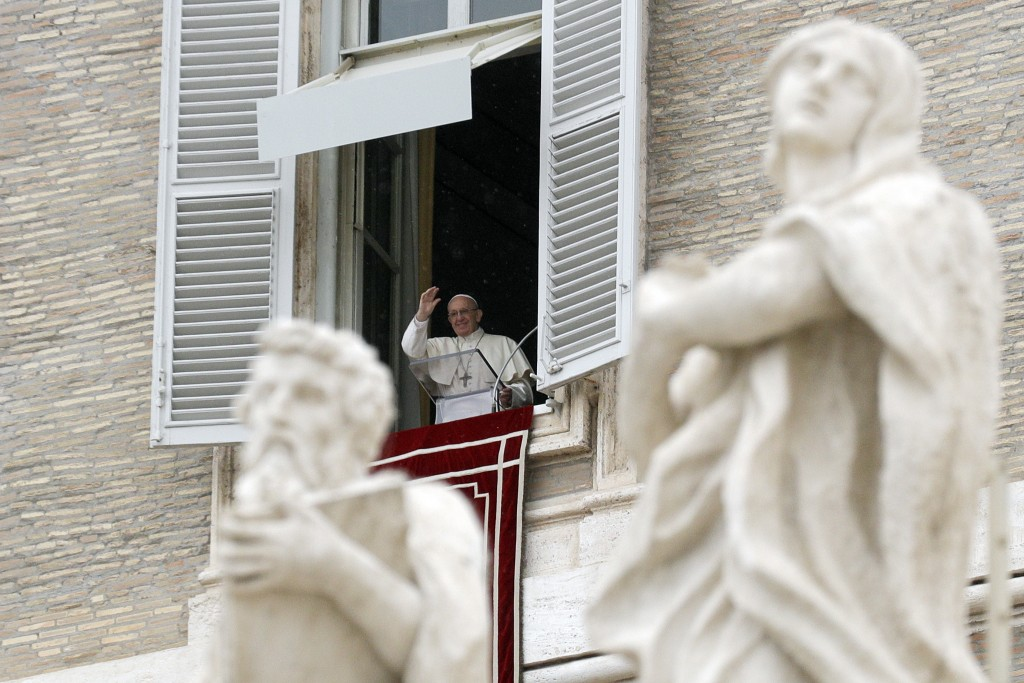 Pope Francis delivers a blessing during the Regina Coeli noon prayer he delivered from his studio window overlooking St. Peter's Square, at the Vatica