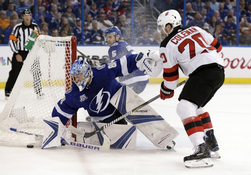 Tampa Bay Lightning goaltender Andrei Vasilevskiy (88) makes a save on a shot by New Jersey Devils center Blake Coleman (20) during the first period o