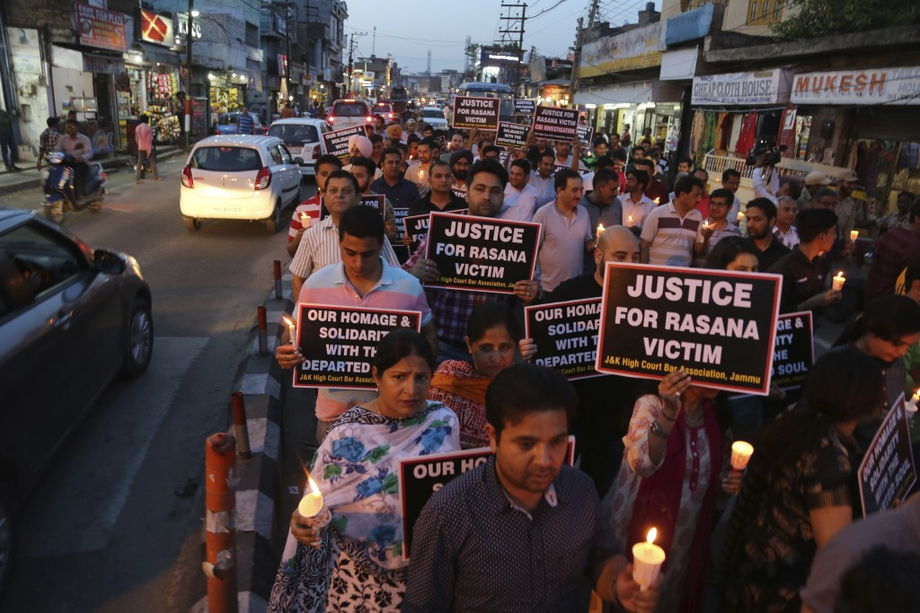 Lawyers participate in a protest against the rape and murder of an 8-year-old girl, in Jammu, India, Saturday, April 14, 2018. The girl was grazing he...