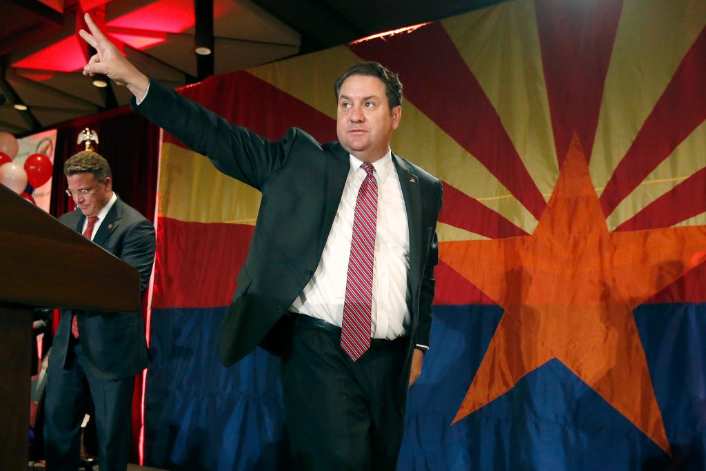 FILE - In this Nov. 4, 2014 file photo, Arizona Republican Attorney General Mark Brnovich waves to supporters at the Republican election night party i