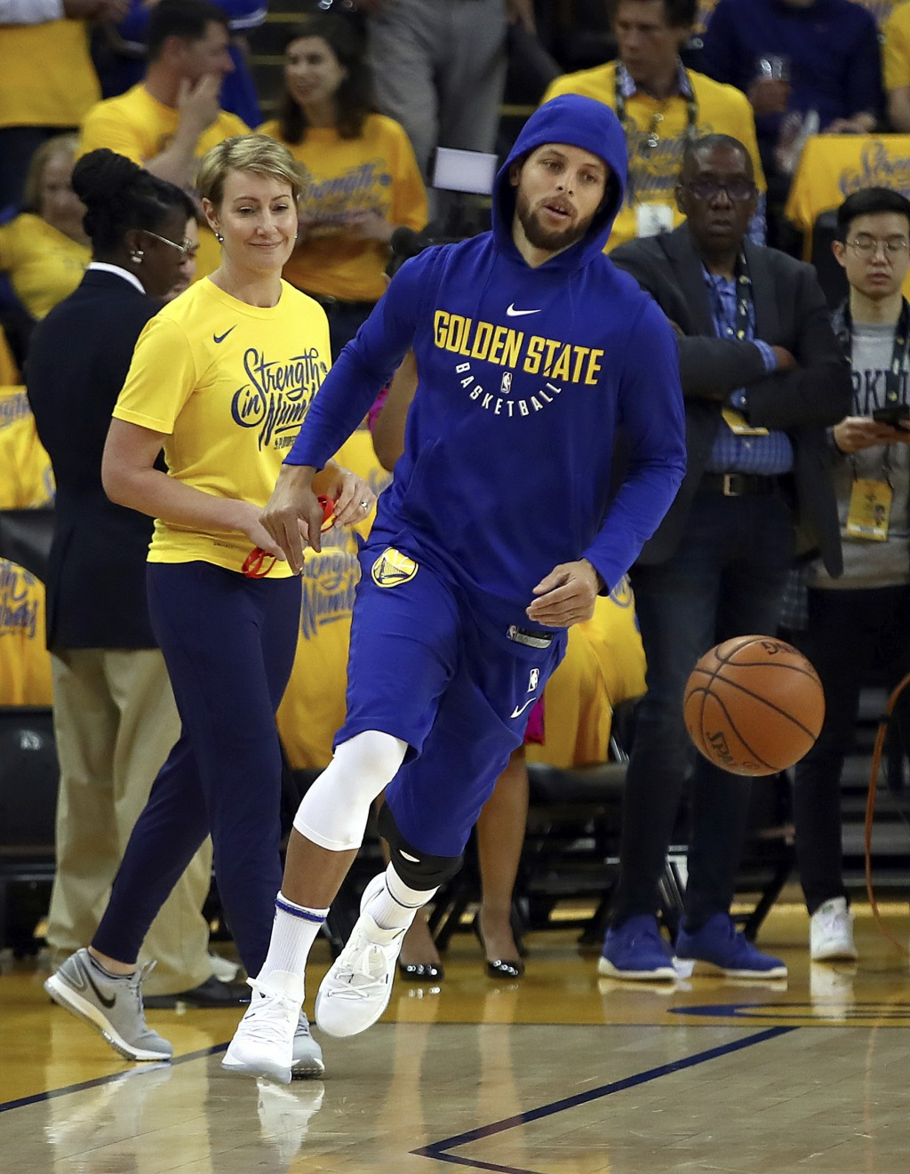 Golden State Warriors' Stephen Curry warms up prior to Game 1 of a first-round NBA basketball playoff series against the San Antonio Spurs Saturday, A