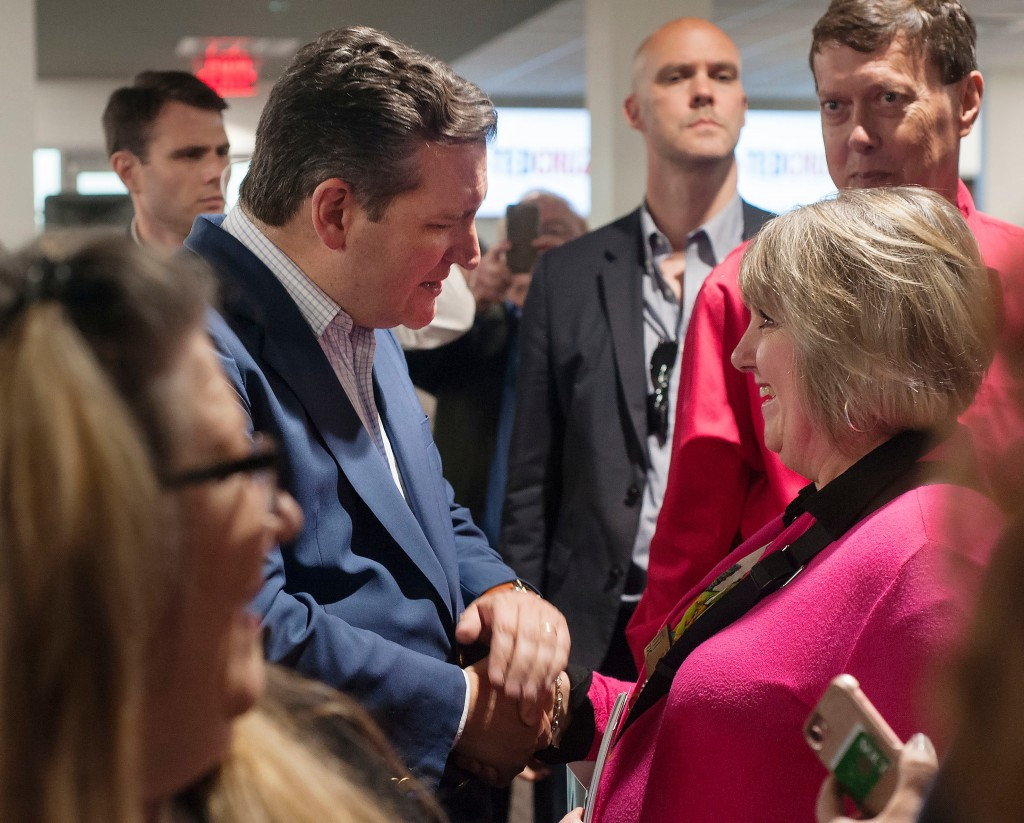 FILE - In this April 2, 2018, file photo, U.S. Sen. Ted Cruz, shakes hands with Cindy Ward during a re-election campaign stop in Tyler, Texas at John