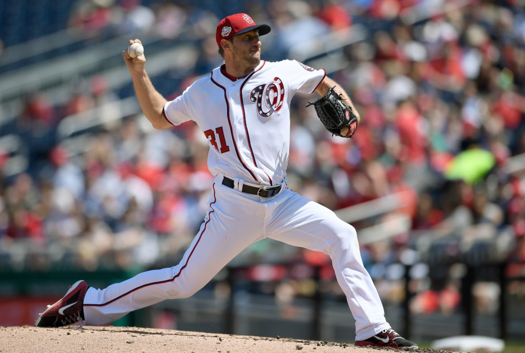 Washington Nationals starting pitcher Max Scherzer delivers a pitch during the fourth inning of a baseball game against the Colorado Rockies, Saturday...