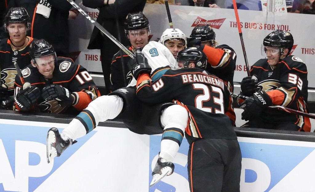 Anaheim Ducks defenseman Francois Beauchemin, right, checks San Jose Sharks left wing Evander Kane into the bench during the first period of Game 2 of