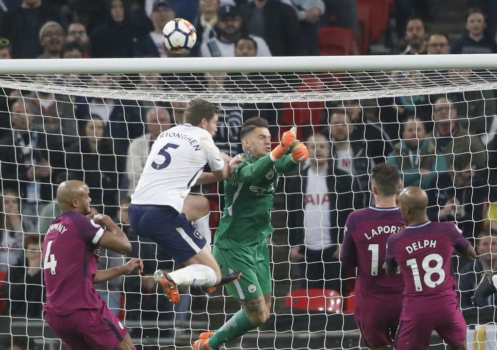 Manchester City goalkeeper Ederson makes a save during the English Premier League soccer match between Tottenham Hotspur and Manchester City at Wemble