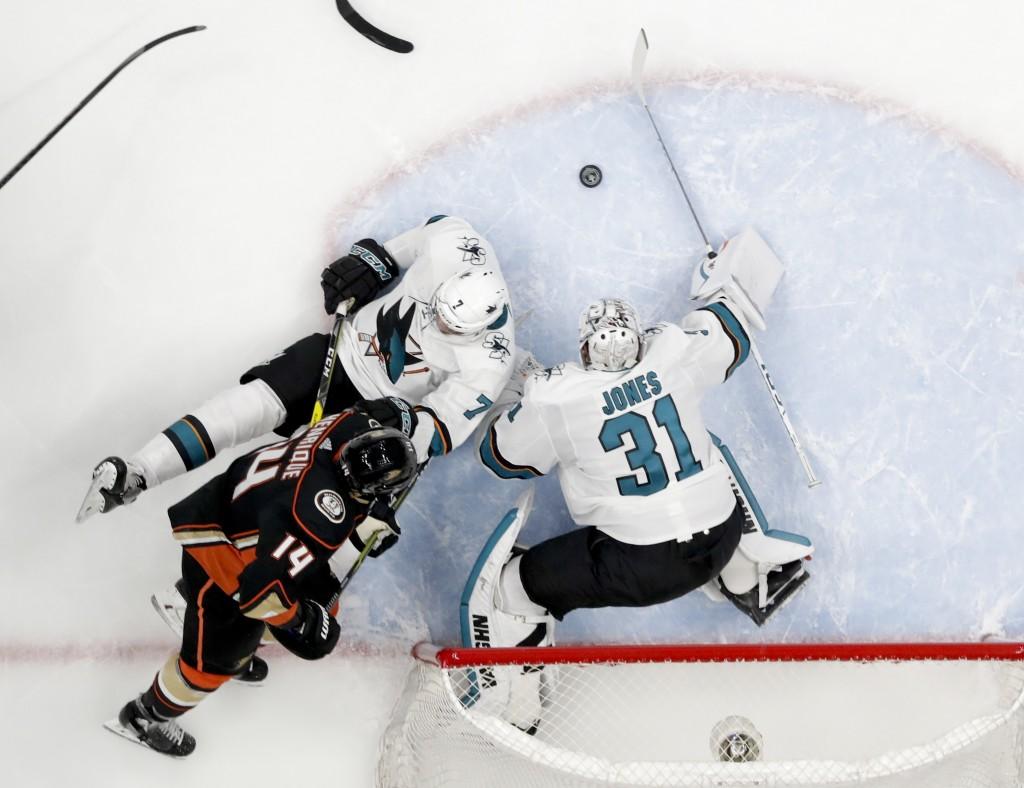 San Jose Sharks goaltender Martin Jones blocks a shot past Paul Martin by Anaheim Ducks center Adam Henrique during the first period of Game 2 of an N