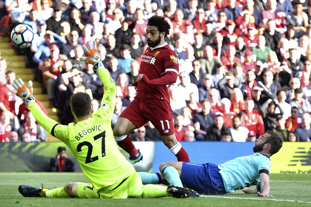 Liverpool's Mohamed Salah, center, sees his shot on goal go wide during the English Premier League soccer match between Liverpool and Bournemouth at A