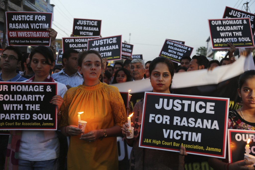 Lawyers participate in a candle light procession in protest against the rape and murder of an 8-year-old girl, in Jammu, India, Saturday, April 14, 20...