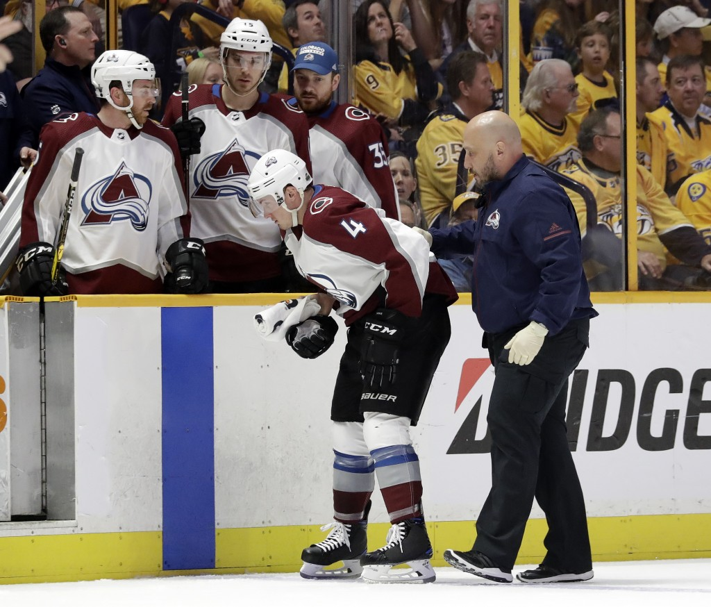 Colorado Avalanche defenseman Tyson Barrie (4) is helped to the bench after being injured during the first period in Game 2 of an NHL hockey first-rou