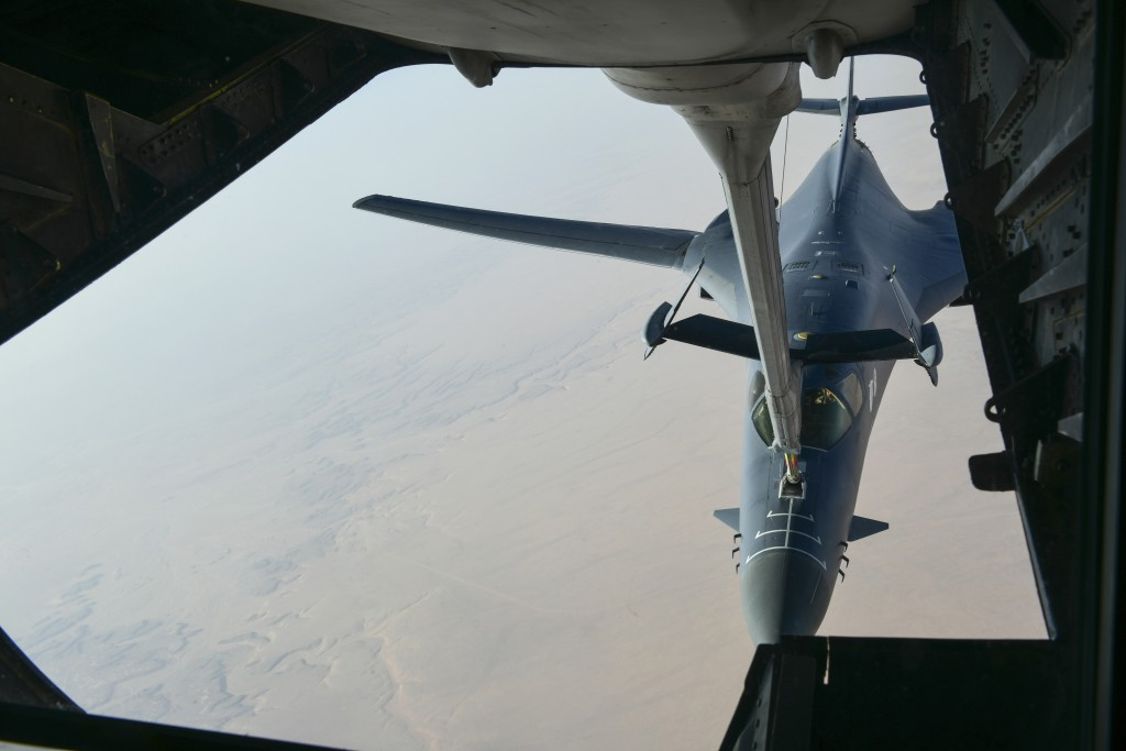 In this image released by the Department of Defense, a U.S. Air Force B-1 Bomber separates from the boom pod after receiving fuel from an Air Force KC...