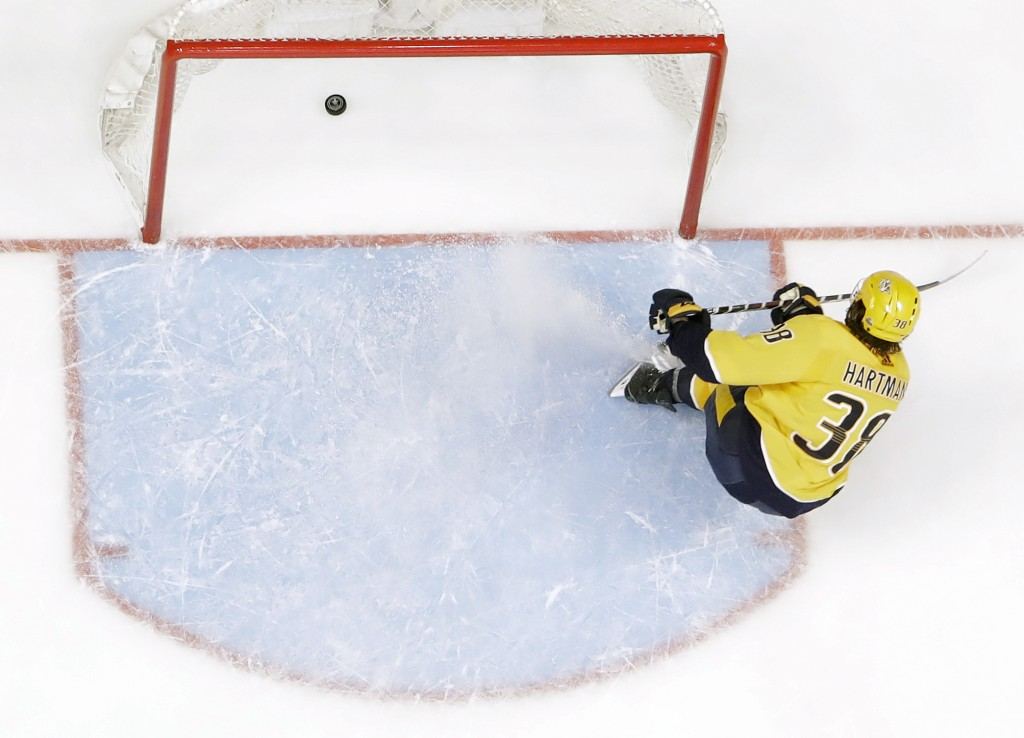 Nashville Predators right wing Ryan Hartman scores an empty-net goal against the Colorado Avalanche during the third period in Game 2 of an NHL hockey