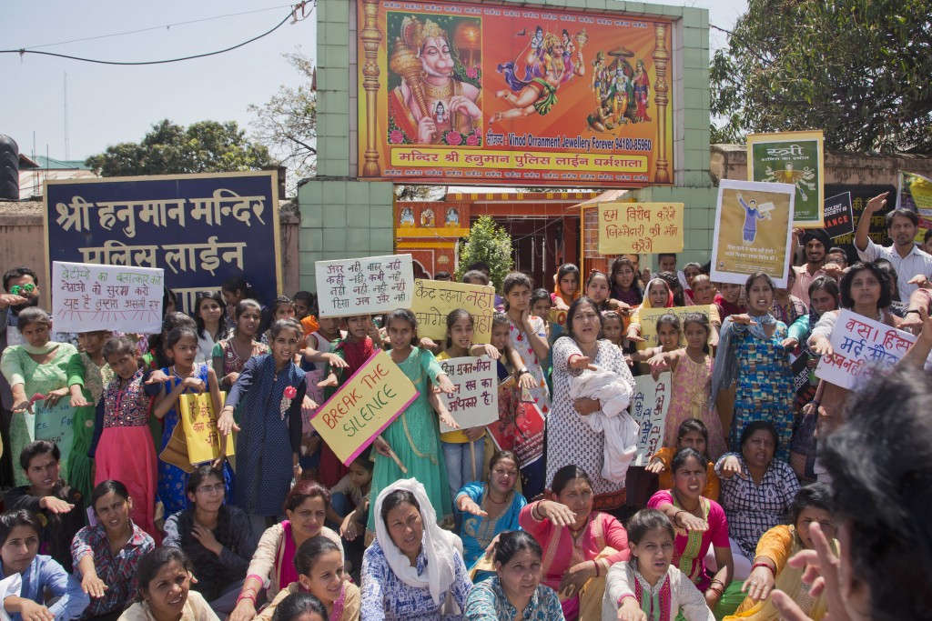 Indian women shout slogans during a protest after gathering in front of a temple of Hindu god Hanunan, to condemn violence against women in Dharmsala,