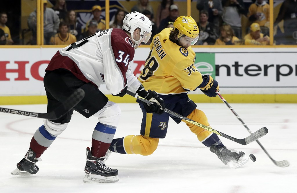 Colorado Avalanche center Carl Soderberg (34), of Sweden, blocks a shot by Nashville Predators right wing Ryan Hartman (38) during the third period in